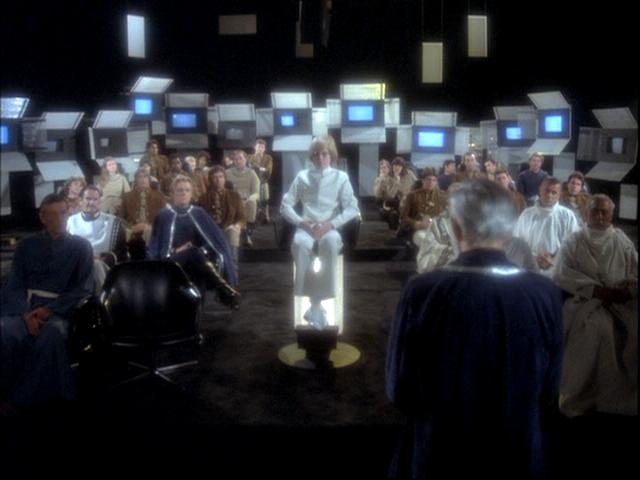 Adama addresses Dr Zee and others in the craptastic Galactica 1980.  Taken from galacticabbs.com